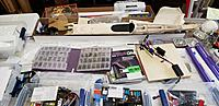 Name: 20200328_154424.jpg Views: 92 Size: 2.60 MB Description: First problem is to clear the building board (dining room table) where there's a partially built SIG Somethin Extra.  What a clutter!