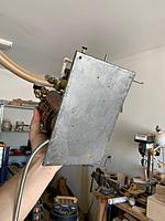 Name: image4.jpg Views: 3 Size: 723.8 KB Description: I didn't have a proper metal break to fold up the edges of the pan I made for the engine, so it had a bit of a warp to it from my hammering the edges over.