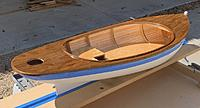 Name: neOYS6NDS++xO9+miWDacA_thumb_14174.jpg Views: 12 Size: 187.3 KB Description: Mike painted the bottom with glossy white Rustoleum and is using epoxy resin to finish waterproofing the interior and deck.
