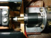 Name: DSC03701.jpg Views: 299 Size: 78.4 KB Description: Brass bushing behind the coupling to prevent it from pulling apart while backing down. (oil shield removed)