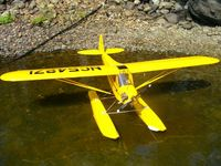 Name: J3 on floats.jpg Views: 277 Size: 72.2 KB Description: Hanger 9 J-3 on Great Planes built up floats.  Saito 56