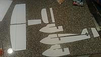 Name: Parts cut out.JPG Views: 7 Size: 634.9 KB Description: My progress so far! :D  No parts are glued, though the KF Doubler is laying on top of the wing halves. Also, I've still got to add the dihedral on the wingtips, as per the plans, as well as cutting the 45d angle for the rudder and elevator.