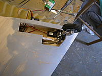 Name: 55 Nose retract finally installed. Had to cut away a lot of rib2 for steeringarm. DSCN1796.JPG