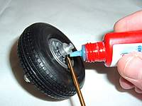 Name: LANDING GEAR 003.jpg Views: 258 Size: 75.3 KB Description: Place wheels on axles and secure wheel collars. I used blue thread locker to help from working loose.