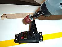 Name: RUDDER SERVO - ELEVATOR 005.jpg Views: 280 Size: 50.5 KB Description: Using a dremel or sanding block remove a small amount of material from -stock HITEC servo arms- to pevent binding with ball link.