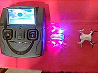 Name: TinyFPV.JPG Views: 10 Size: 83.2 KB Description: The one that's lit up is the H111D and that's the remote for it. Has the H002 in the pic on the remote. The 002 flies a LOT better, and has a cam, but just records on an SD card.
