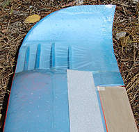 Name: Dancer3l.jpg Views: 330 Size: 127.9 KB Description: Forward corner of wing tip outer end was carved away to this more sweeping contour; edges carved & then heat-formed & tempered. 4mm step at 50%, 2mm thick filler panel in place behind that.