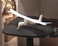 Name: Picture 001.jpg Views: 368 Size: 14.6 KB Description: Plane posing on untidy chair