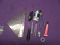 Name: M1380006.jpg Views: 718 Size: 303.6 KB Description: First, lay out your tools and supplies...a square, Phillips and flat-head screwdrivers, tweezers, CA, the ubiquitous Welder glue, hobby knife with fresh blades, wire cutters, and new for this build: Blenderm tape.  Also recommended but not shown is a good