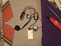 Name: M1380099.jpg Views: 689 Size: 274.7 KB Description: Now it's time to install some servos.  Plug in all of your electronics and test them.