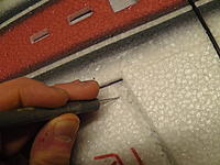 Name: M1390003.jpg Views: 592 Size: 261.6 KB Description: Clean out the slots for the aileron horns on the ailerons.