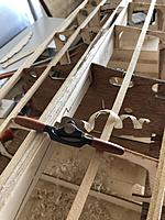 Name: IMG_2424.jpg Views: 71 Size: 3.46 MB Description: The right tool for the job. Just starting to shape the keel. While technically this was just a Christmas present it was actually a good tool for removing most of the material.