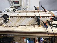 Name: IMG_2459.jpg Views: 35 Size: 3.72 MB Description: Almost all the way to the stern and started on the planking towards the bow. The planks get a little fiddly closer to the stern (and bow) as they bend around the curves. Some creative clamping was required :).