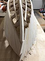 Name: IMG_2472.jpg Views: 35 Size: 2.72 MB Description: Second side finished with planks overlapping the first side planks at the stempost. It's a little tricky figuring out how much angle to sand where the sides and hull planks will meet at the bow. Not sure I've got it right.
