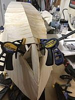 Name: IMG_2481.jpg Views: 27 Size: 3.09 MB Description: Working towards the stempost got a bit slower as the curves got tighter. These were the last boards I could clamp in place. Even these boards would have benefited from bending prior to fitting but I got them in without.