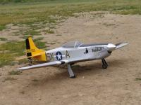 Name: Mustang on the ground.jpg Views: 76 Size: 132.0 KB Description: 67 inch span weighing in at just under 10 lbs. and lifts off in under 30ft.!