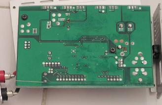 Solder side of circuit board.  There are two small spots where they didn't clean off the soldering flux.