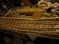 Name: DSCN0001 (2).jpg Views: 70 Size: 294.2 KB Description: Wing sections joined. Centre section ribs are trimmed down to allow the sheeting to come flush with the spars. Looks a little neater and cleaner this way. Laying the sheeting over the spars is a little stronger, but then it stands out by its thickness.
