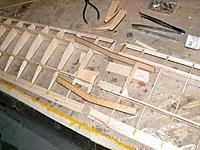 Name: DSCN0053.jpg Views: 72 Size: 295.4 KB Description: Left and right wing sections before joining.  It is easier to set the centre rib angle at this stage, rather than ealier.  The brace determines the correct angle. TE sheeting missing