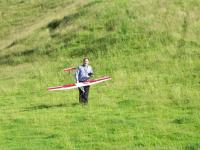 Name: 100_7004.jpg Views: 202 Size: 154.8 KB Description: Swanlander and his Glider [he was the first to take to the air].