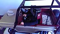 Name: Tonka inside.jpg Views: 107 Size: 363.2 KB Description: This pic is G.I. Joe in the driver's seat. I replaced his head with a Gopro camera mounted on a360 degree servo so I can look around when driving. There is another servo attached for looking up and down. movement.