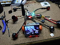 Name: DSCF0115[1].JPG Views: 11 Size: 7.34 MB Description: For who's wondering, that's a watch fpv monitor that had it's usb rip out after like four charges. I gently removed it from it's case and built a stand from a 3AH 18650 and wired that in, with a new charging plug that fits my 1s charger.  Runs for aaaages