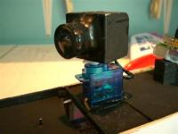 Name: Photo (Small).jpg Views: 398 Size: 41.8 KB Description: The cam is install on Hitec HS-55 servo for panning, no tilt movement. This camera is only for benchtest, the case is handmade and the lens is glue ...
