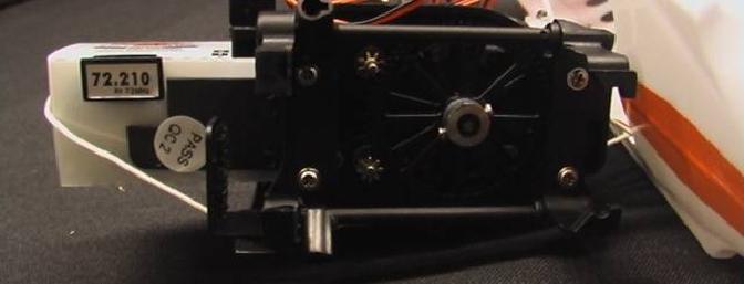The brass pinion gears drive nylon rotor gears.
