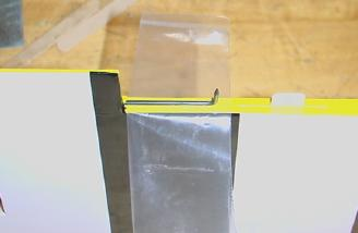 I did have to glue the control horn into the aileron. A small piece of plastic behind the linkage kept the glue from getting where it did not belong.