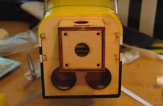 Motor mount with ventilation holes.  The mount is all constructed with lite-ply.