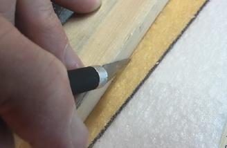 Use a straightedge to make the cut for the stiffening strings