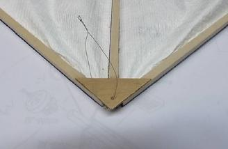 You can use the thread to hang the sail when not in use.