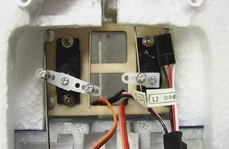 Servos are securely mounted with lite-ply.