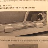 Use the transmitter boxes under the wing tips to assist in bending.