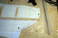 Name: DSC_5634m.jpg Views: 265 Size: 64.8 KB Description: The outermost rib was used to mark off how much to trim off of the keel