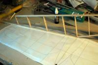 Name: DSC_5642m.jpg Views: 245 Size: 67.4 KB Description: The leading edge was pinned down with one side sticking up and the rib/keel assembly was glued into place, using the plans as a guide for placement