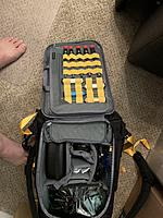 Name: IMG_0152.jpg Views: 50 Size: 4.10 MB Description: Inside of backpack.  Also shows some tools that are available.  T100 lipo powered soldering iron and various hand tools for drone work.  Asking $50