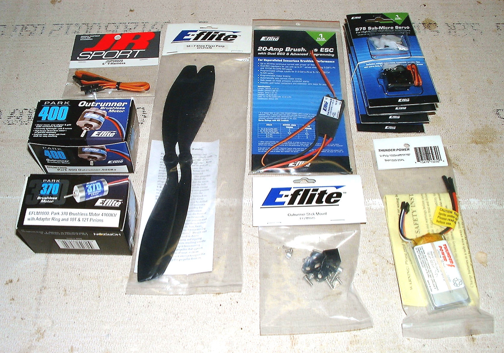 Name: stuff.jpg Views: 958 Size: 440.9 KB Description: All the additional E-Flite components needed to get in the air.