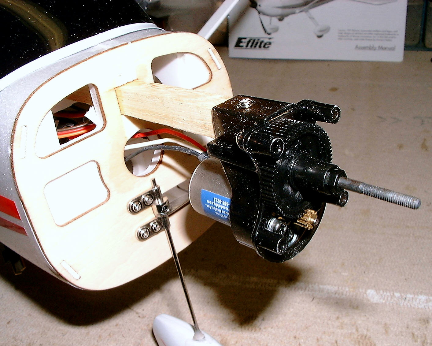 Name: engmnt3.jpg Views: 689 Size: 246.2 KB Description: Motor installation couldn't have been simpler. I just slid the mount over the stick, drilled a pilot hole and inserted the screw. And it was done!