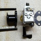 Complete carb assembly with velocity stack, gasket and mounting screws.