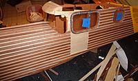 Name: DSC00043.JPG Views: 19 Size: 673.6 KB Description: Windows in and planking almost all done on this side, as well as cabin to hatch.