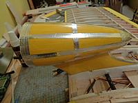 Name: DSC00156.JPG Views: 8 Size: 618.1 KB Description: Got the pylon covered and trimmed, and installed it in the center wing section.