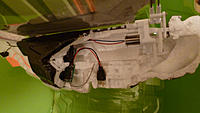 Name: P1000378.jpg Views: 158 Size: 82.5 KB Description: The DT Rx42 is tucked into the back of the body, just held in by the foam.  If the actuator wires had cooperated, it would have been further forward, where the original IR Rx was