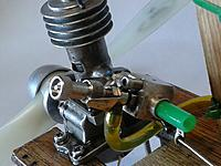 Name: 2018-09-23 14.52.56.jpg Views: 29 Size: 1.11 MB Description: Homemade carb epoxied to stub.  Inlet diameter reduced with green plastic tube.  Enya needle assy.