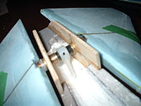 Name: 13-NOV-2012 (6).jpg Views: 68 Size: 146.9 KB Description: Carbon spar go 2-1/2 inches into the wing.  A 1/2x1/2 brass tube, cut and soldered at 30 deg is glued to the spar in the wing.  The other half of the angled tube runs through a brass bushing in the ply support and is glued to the pivot tube.  When operate