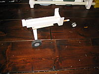 """Name: Flaps 006.jpg Views: 95 Size: 197.5 KB Description: Built this (hopefully) launch trolley. Big wheels for grass, the foam  """"pin"""" at the front slides into the front gear well when the gear is retracted."""