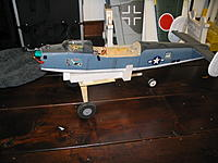 Name: Flaps 007.jpg Views: 122 Size: 189.3 KB Description: Built it so the plan rides nose up, should get it in the air more quickly. Taxis okay, and when I pick the plane up by hand, the dolly falls free every time.