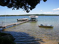 Name: 000_0105.jpg Views: 123 Size: 124.2 KB Description: Chase Boats. Paddle Boat, The Duck Boat, (camo one) Yellow Larson 14 ft. ski boat, Mastercraft pro ski boat under the canopy.