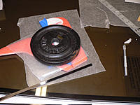 Name: P1060607.jpg Views: 103 Size: 136.4 KB Description: Glue drying.  Pictured is the piece of carbon fiber I used.
