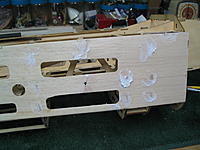 Name: IMG_0184.jpg Views: 60 Size: 204.9 KB Description: Upper and lower balsa sheeting completed. Light weight filler applied and waiting for sanding.